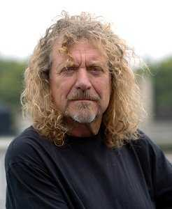 Robert Plant Signs His 10 Foot Gibson Les Paul Guitar